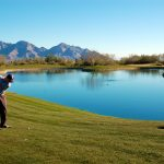 Fairway wrapping around the lake on the golf course at the Stone Canyon Club in Tucson Arizona