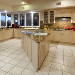 Gourmet kitchen complete with island and granite counters in a luxury golf home in Tucson, Arizona